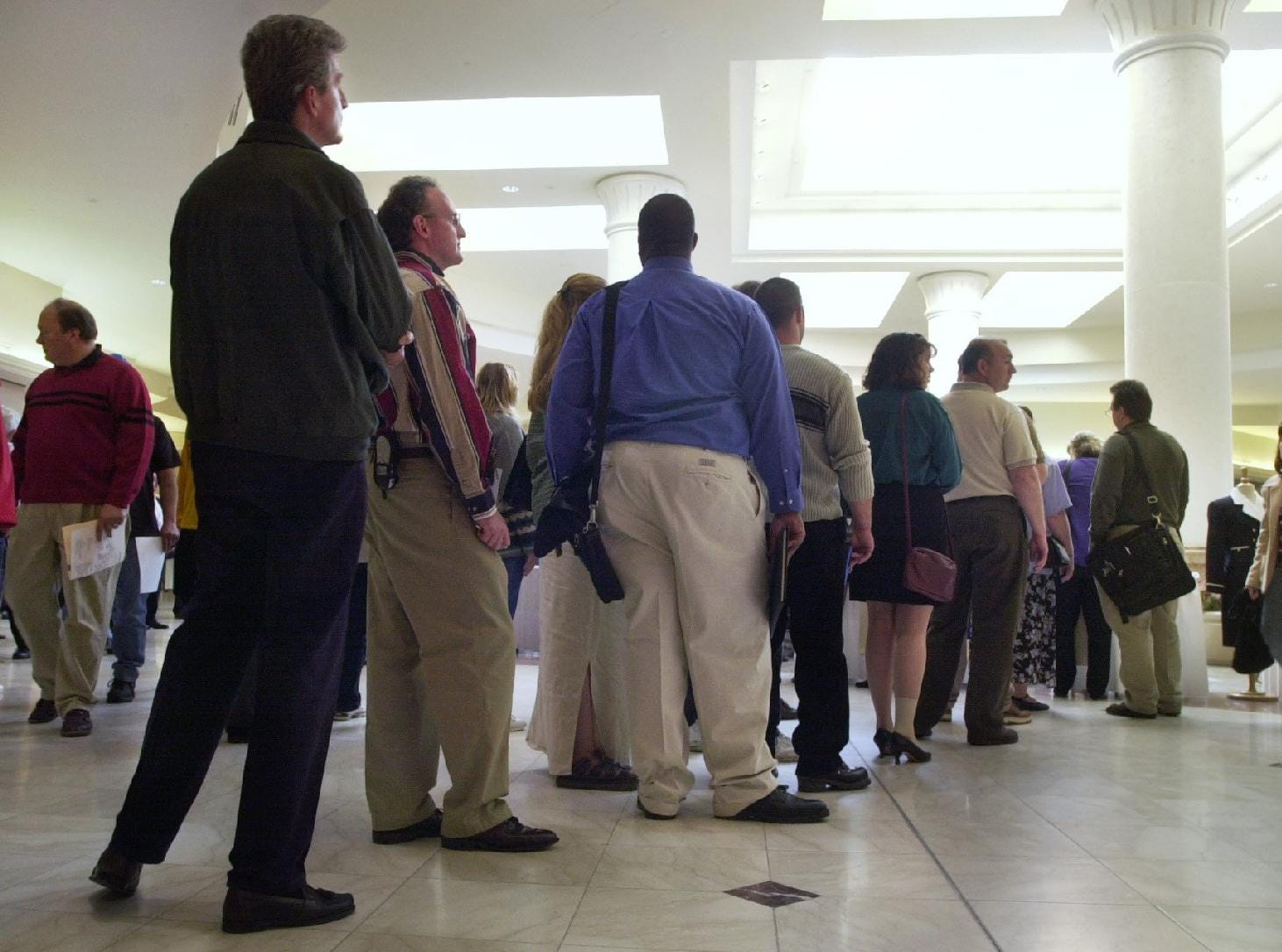 The lines were long in front of the NLX Corp. table for the sixth annual Southern Tier Job Fair held on May 21, 2002 at the Oakdale Mall as people waited to get job information and turn in their resumes to the Town of Union company, one of 53 employers represented that year.
