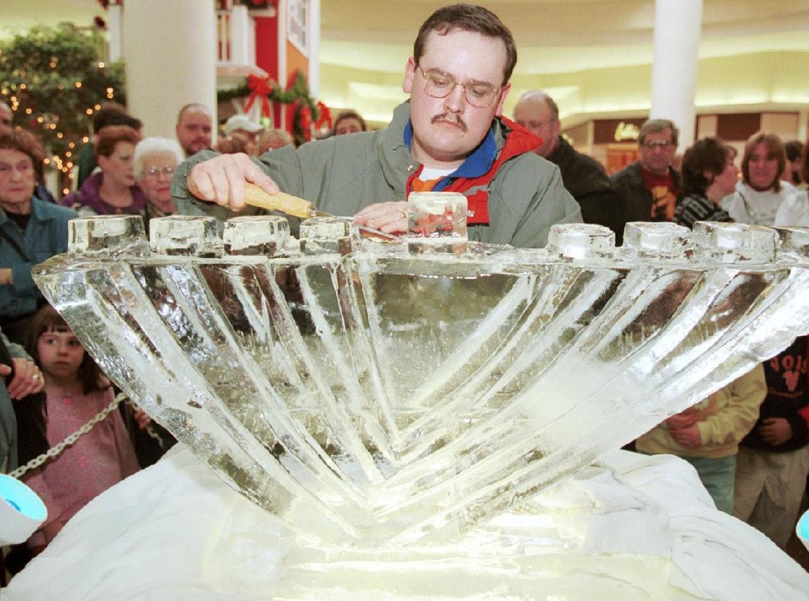 Ice sculptor Lou Markowsky puts the finishing touches on a Menorah before it was to be lit as part of the hanukah celebration at the Oakdale Mall in Johnson City on Dec. 20, 1998.
