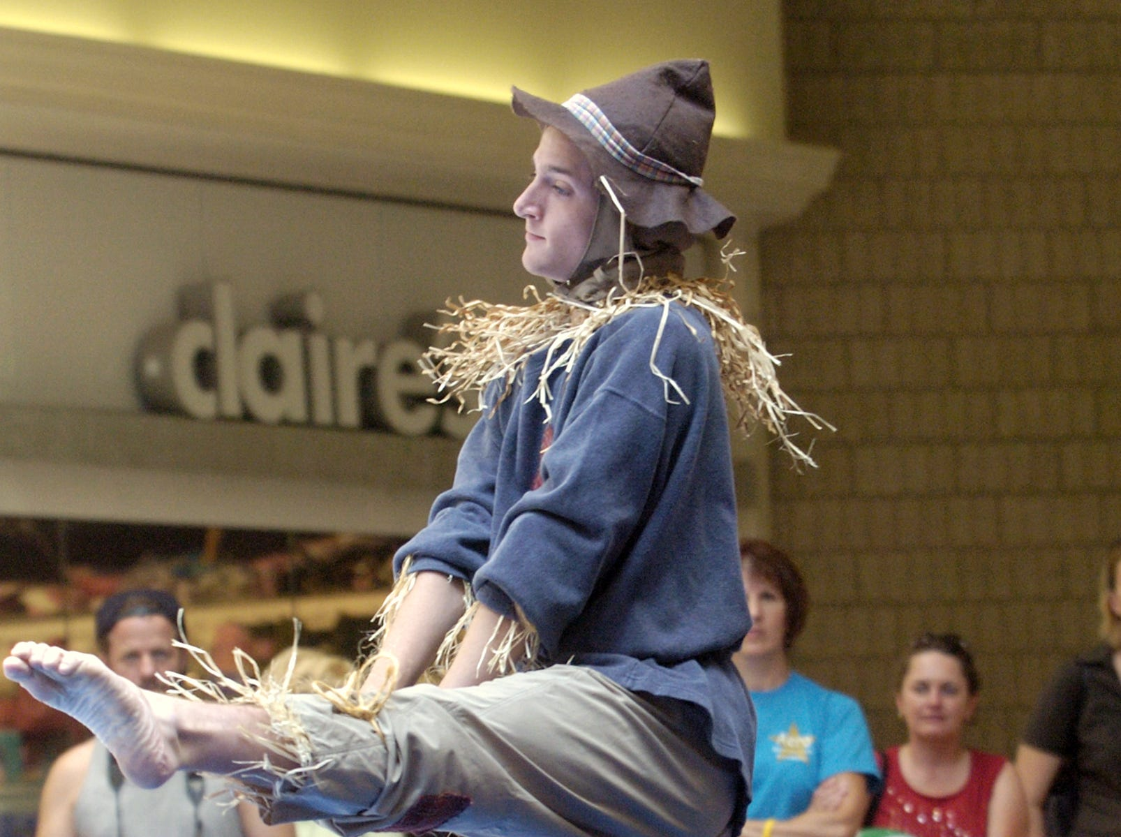 Tony Mitchell, 17, a senior at Chenango Valley High School, performs as the scarecrow during a Lighthouse Productions exhbibition August 5 at the Oakdale Mall.
