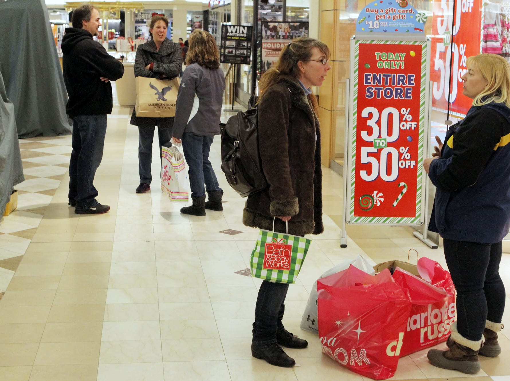 Bonnie Poyer, of Whitney Point, center, and her sister, Lori Johns, of Greene, shop  at Oakdale Mall in Johnson City in November of 2013.