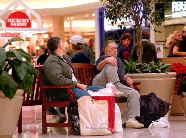 L,R, Joel Blincoe of Harpursville and Damian Silipo of Susquehanna, P.A., take a rest in between shopping at the Oakdale Mall during one of the most busiest shopping days of the year, Friday November 29, 1996.