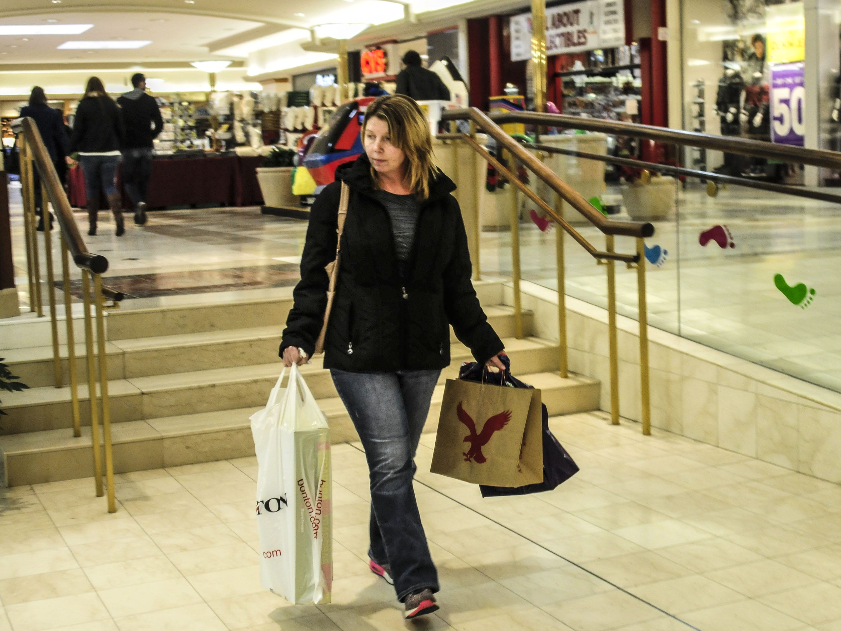Laurie Lasky, of Conklin, shops at the Oakdale Mall in Johnson City on Dec. 26, 2013. She said she waits until after Christmas to buy some items. That year, Lasky went to the mall at 7:30 a.m. looking for a post-Christmas deal on dress boots.