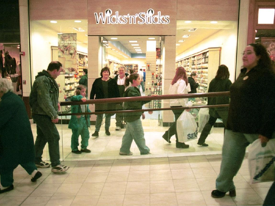 Shoppers file down the hallway at the Oakdale Mall in November of 1998.