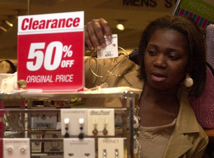 Linda Frimpong, a Binghamton University student from the Bronx, looks at earrings to buy at the Bon-Ton Department Store in the Oakdale Mall on April 2, 2004.