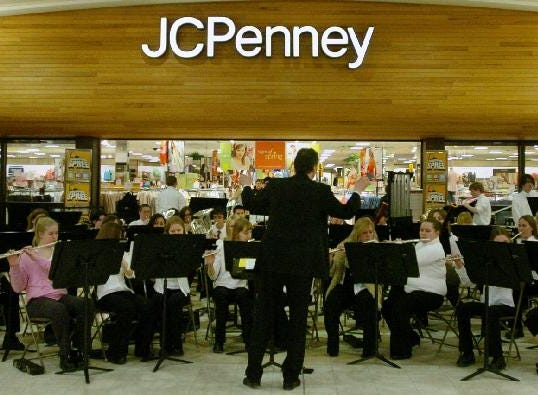 nder the direction of Mike Carbone, the Johnson City High School Concert Band performs at the Oakdale Mall on March 7, 2005 as part of the Music in our Schools Month, sponsor by the Broome.