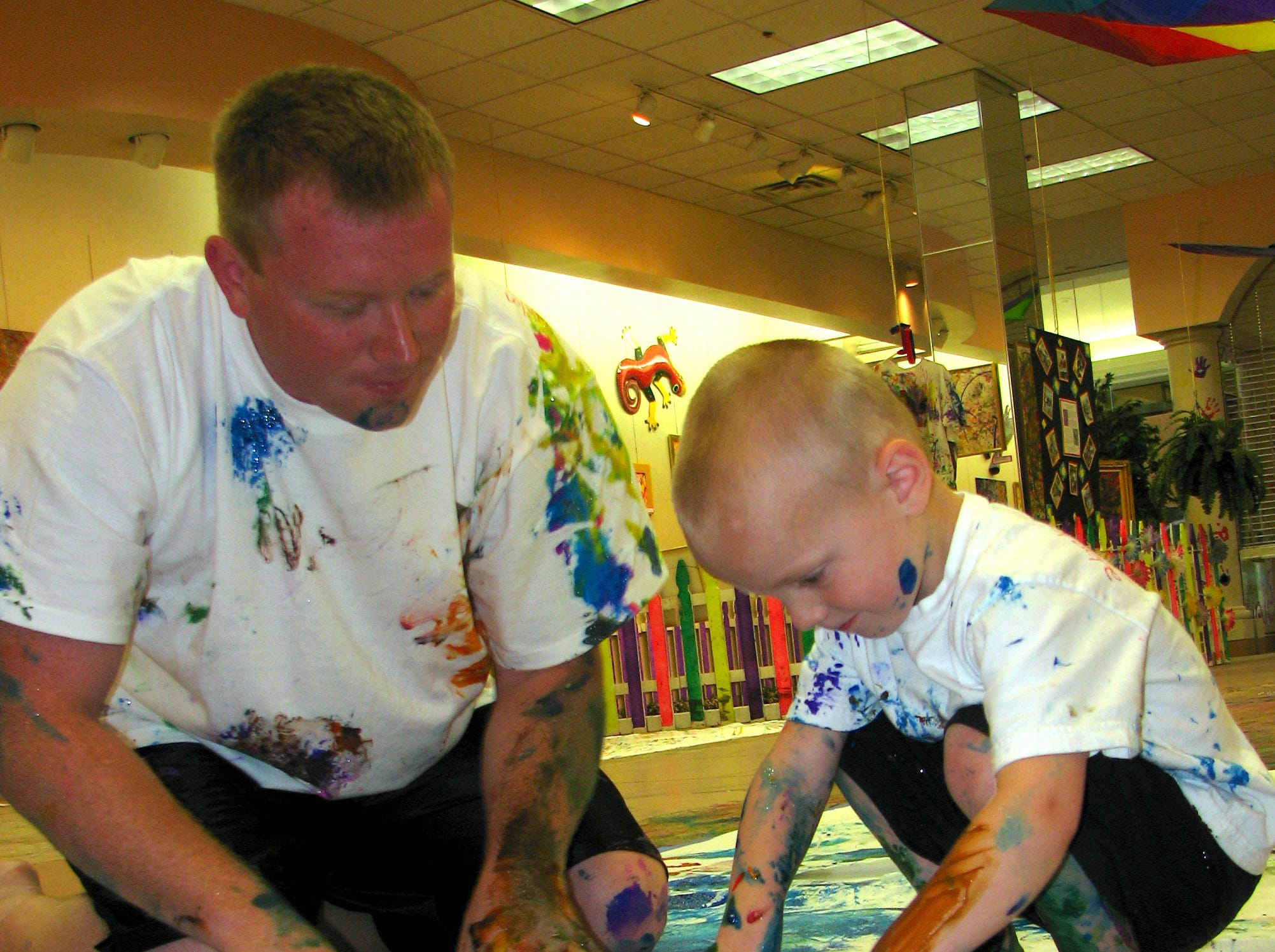Kevin McLean of Lisle paints with his son Ryan, 3, as The Magic Paintbrush Project served its 2000th particpant in June of 2007. According to Project organizer Jennifer O'Brien, a few statistics... Over 700 gallons of paint 4,000 square feet of donated workshop space from the Oakdale Mall. Over 4,500 hours of volunteer time.