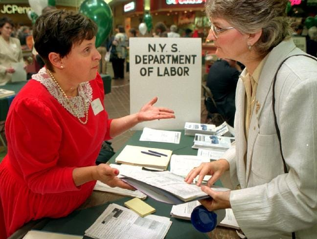 Brenda Kuenzli of Candor, right, gets job information from Sara Wokan, a labor services rep with the New York Department of Labor during the 40+ Job Fair at the Oakdale Mall on Oct. 29, 1996. Over 1000 people came to talk to company representatives and get job search tips from local agencies.