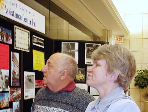 Joe and Sharon Gould take one last look at the memorial wall at the Oakdale Mall, which contained pictures and other personal information about local victims of crimes in April of 2007. Tom Gould, Joe's son, was shot to death in 1995.