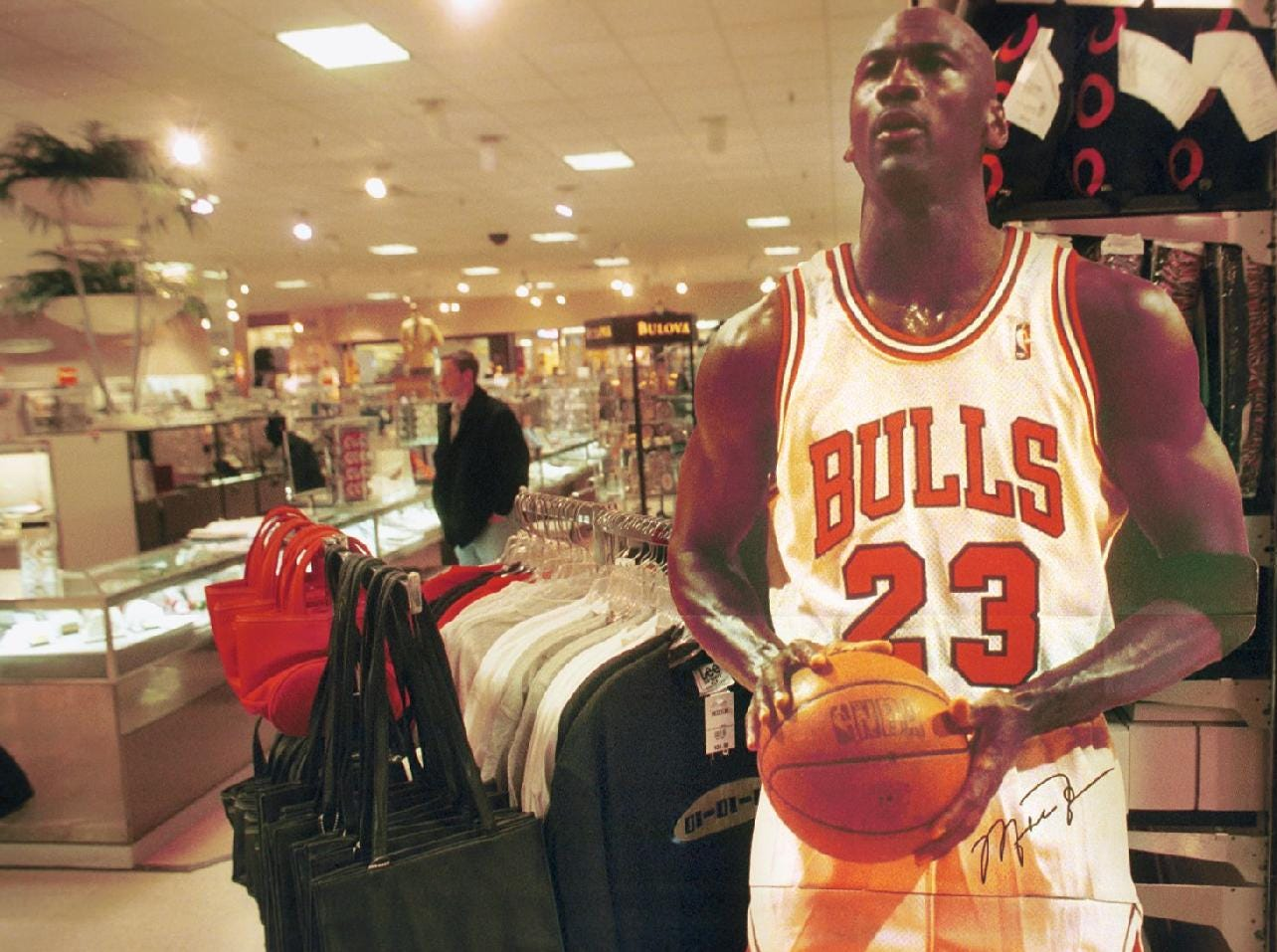 -No, that's not actually Michael Jordan at JCPenny in the Oakdale Mall, but a cardboard cutout promoting Michael Jordan Cologne. He's pictured here in January of 1999.