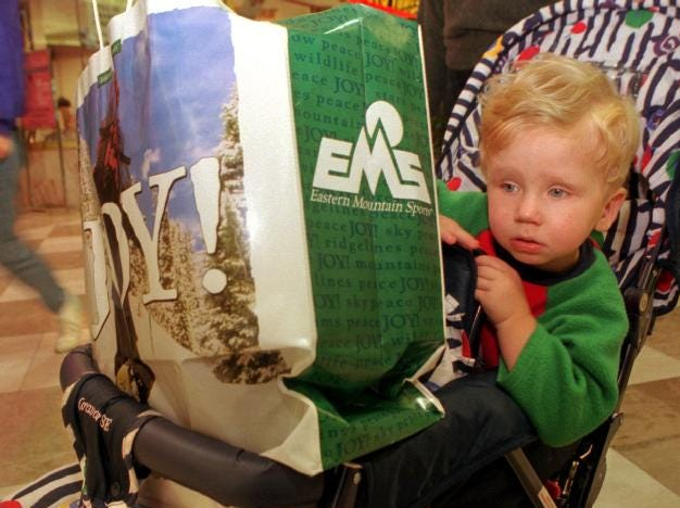 -With presents blocking his view, two-year-old Joshua looks a little weary in his stroller while with his mother, Carrie Mozgawa of Owego, finishes up with her holiday shopping at the Oakdale Mall on Dec. 23, 1997.