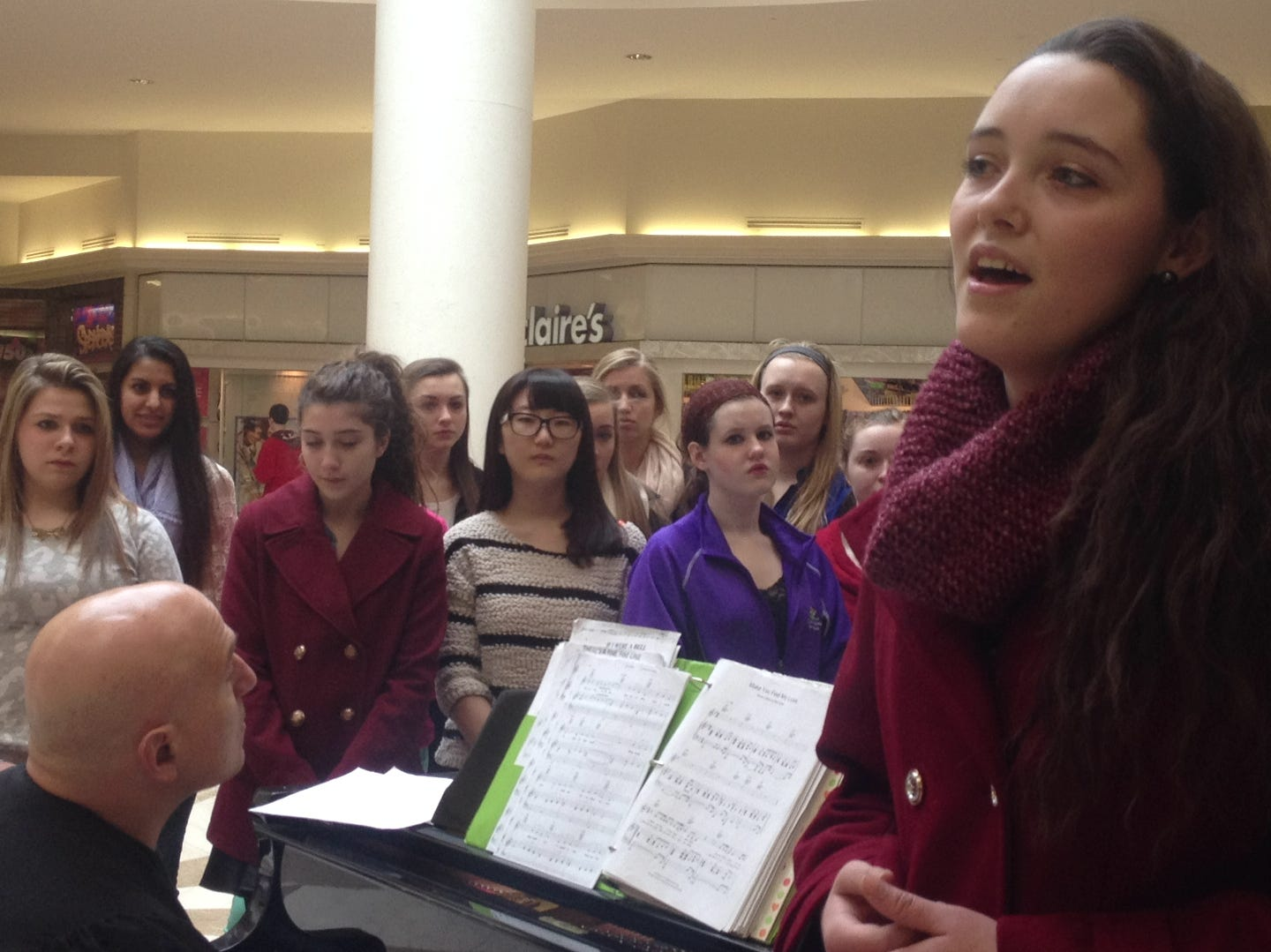 "Larissa Yost, an 18-year-old senior and Endicott resident, sang ""Part of Your World"" from Disney's Little Mermaid on Sunday in the Oakdale Mall in January of 2014."