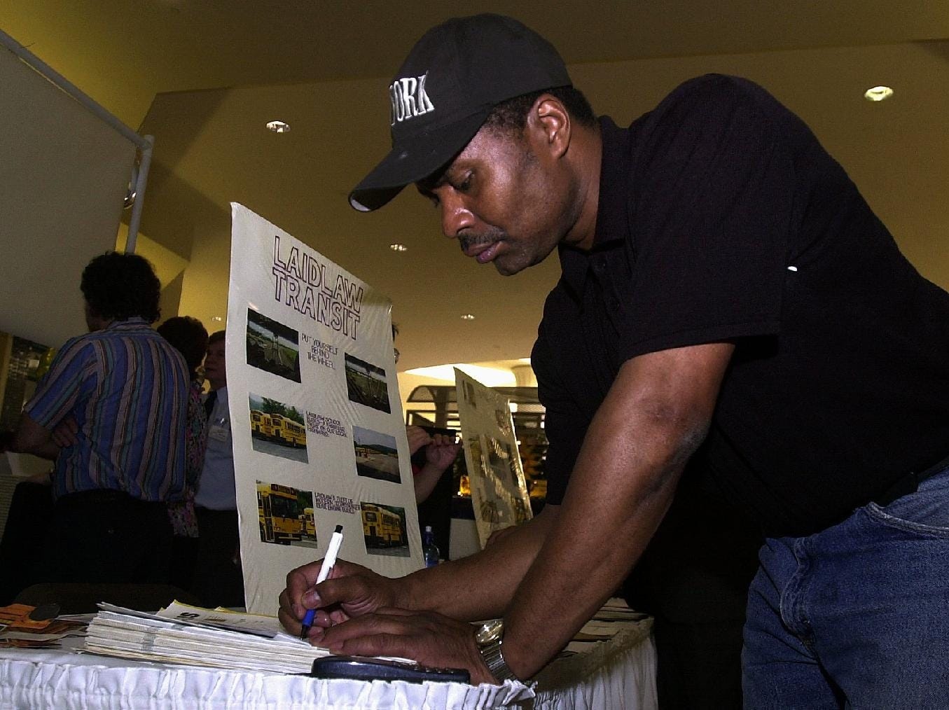 Broome Community Collage student Dennis Cooper of Binghamton, fills out a application for Laidlaw Transit took advantage of the Greater Binghamton Area Job Fair on June 10, 2003 at the Oakdale Mall to look for a part-time job.