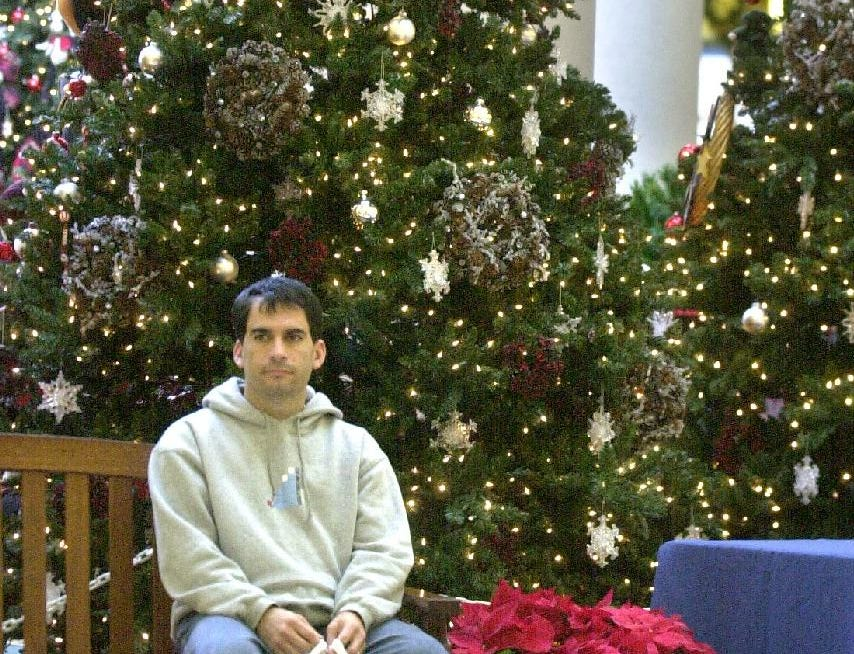 Chris Hatem of New Hampshire waits for his family at the Oakdale Mall in Johnson City on Nov. 26, 2004.