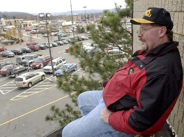 Glenn Pitcher, a disc jockey from WHWK, sits on the roof of the Oakdale Mall in Johnson City on Nov. 25, 2004 where he will spend a night to simulate homelessness. The stunt wa designed to raise awareness about the problem of homelessness and also acts as a fund-raising activity for Volunteers of America. Pitcher has been participating in the event for six years.