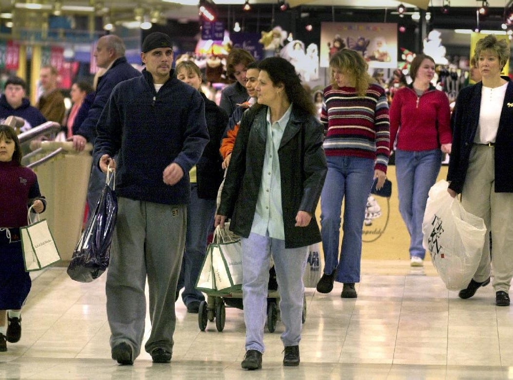 Shoppers fill the Oakdale Mall in Johnson City on Black Friday, the busiest shopping day of the year, on Nov. 29, 2002.