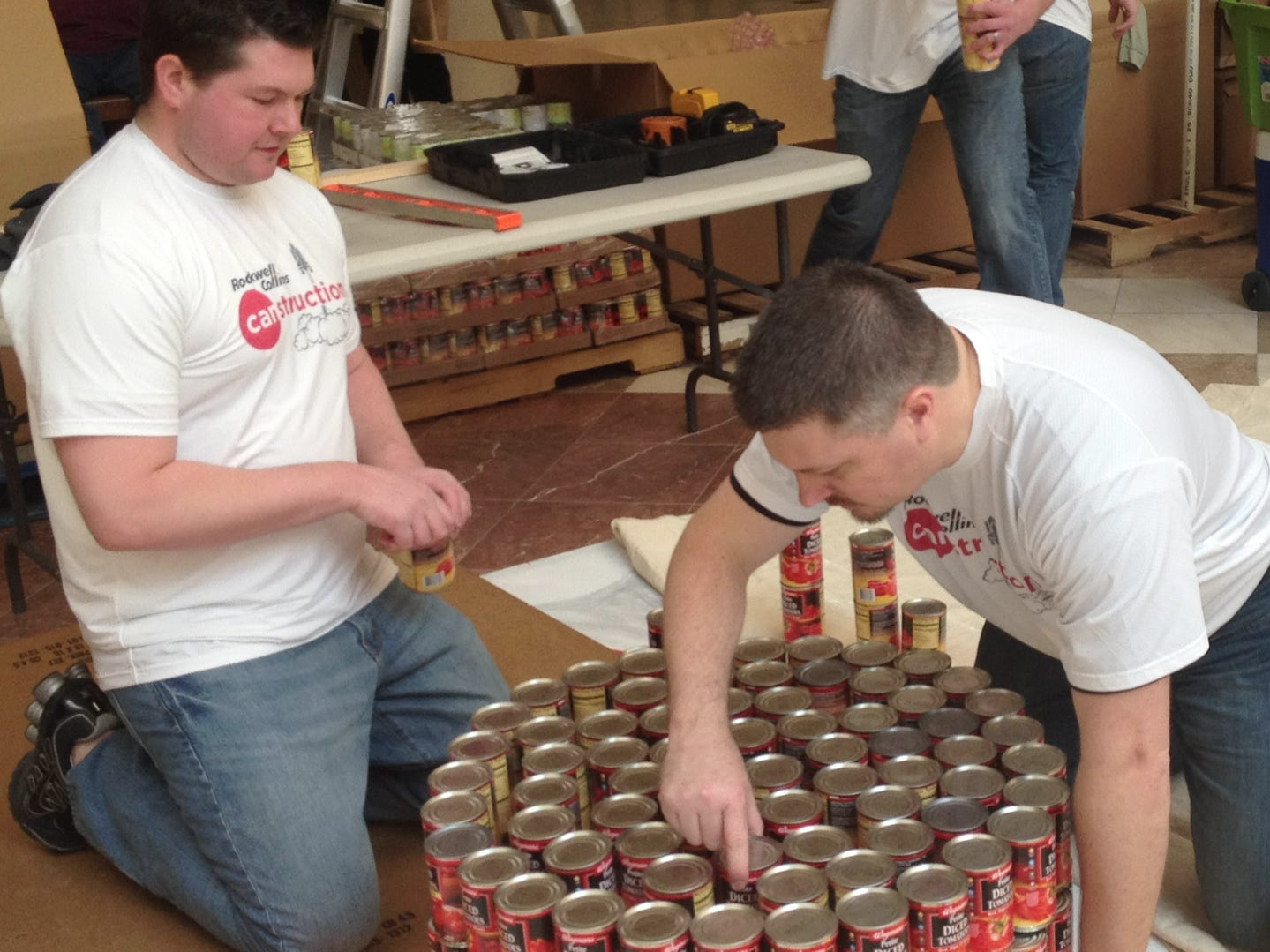Eric Chidester, left, a Binghamton resident and structural engineer at Rockwell Collins, and Justin Lis, a Town of Maine resident and engineering manager at Rockwell Collins, help create the team's space shuttle on Sunday at the Oakdale Mall as part of Canstruction in March of 2014.