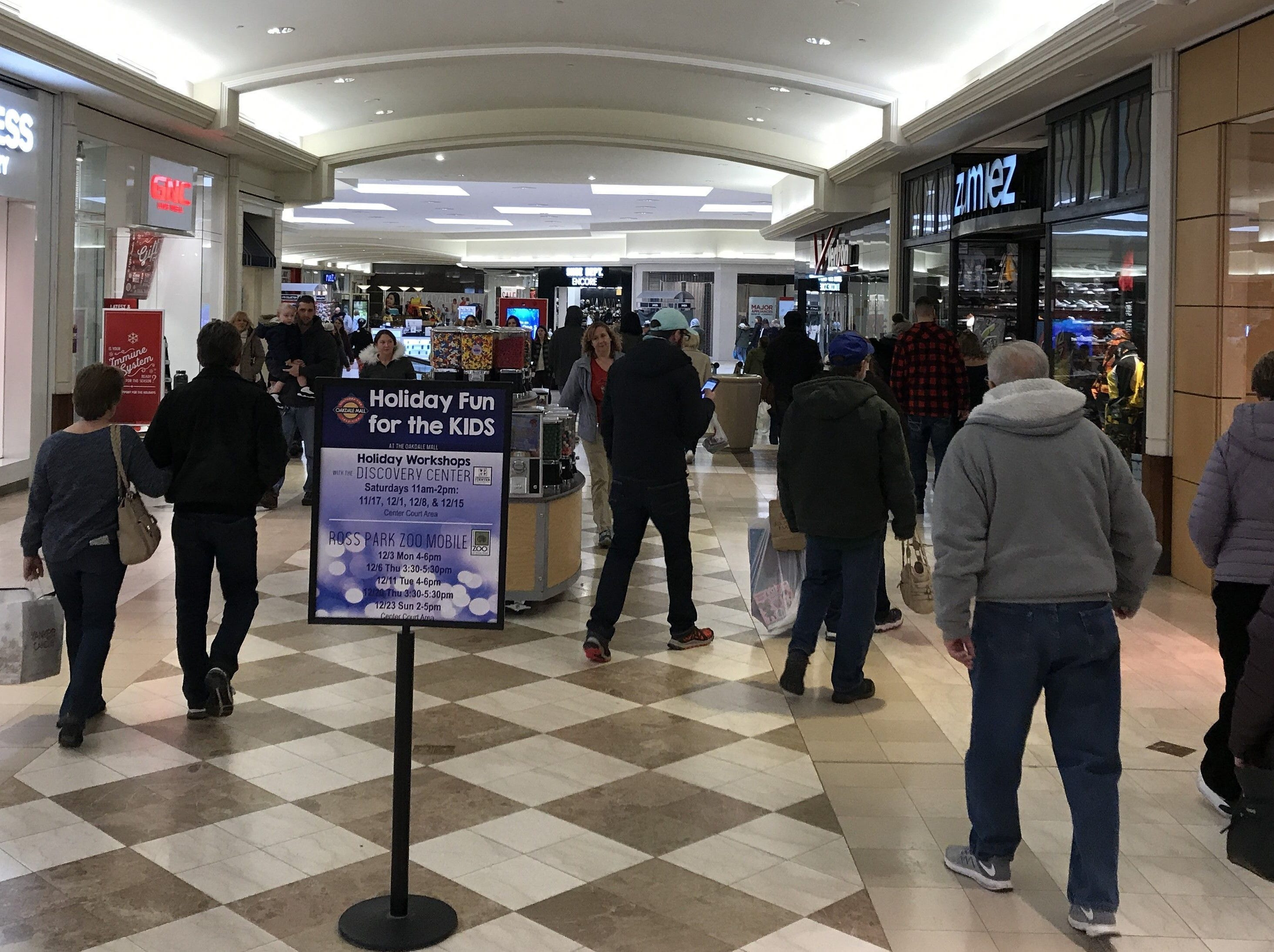 Shoppers walk the Oakdale Mall in search for Black Friday bargains on Nov. 24, 2018.