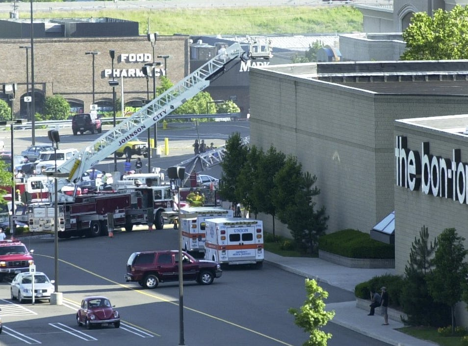 Johnson City and Binghamton departments work on a fire at the Oakdale Mall the evening of June 23, 2004.