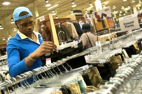 Toni Copeland of McDonough shops at Burlington Coat Factory at the Oakdale Mall on Aug. 6, 2003, the stores first day of business. Copeland said she has shopped at other locations of the store and likes the sales and different style of clothes.