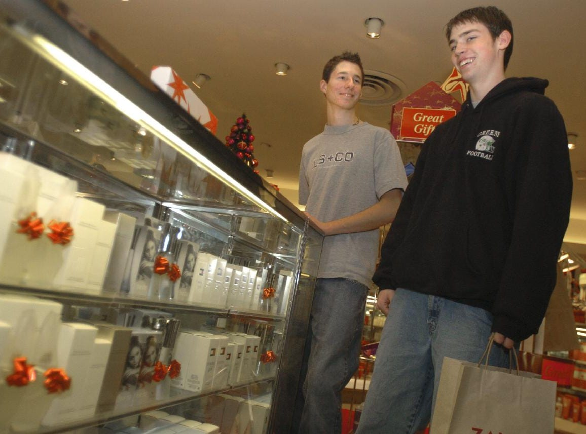 17-year-old Andrew Pfeil, right, joins his friend, Lucas Beamer, 17, at the perfume counter in Bon-Ton Department Store at the Oakdale Mall on Dec. 24, 2004. The two Greene residents were in search of gifts for their girlfriends on the last shopping day before Christmas.