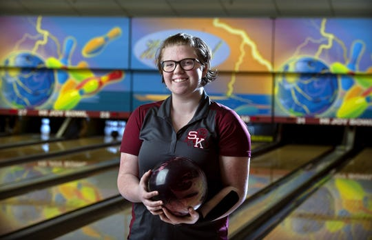 South Kitsap senior Abigail Kay is one of the state's top 4A bowlers, despite competing with rheumatoid arthritis. .