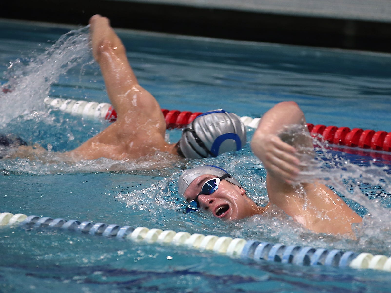 Haakon Meyer (front) swims during practice at the Olympic High Pool on Wednesday, January 30, 2019.