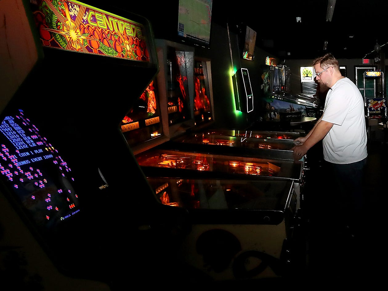 Richard Godwin, co-owner of Tik Tok's Workshop plays a game of pinball at his establishment in Bremerton on Wednesday, January 30, 2019.