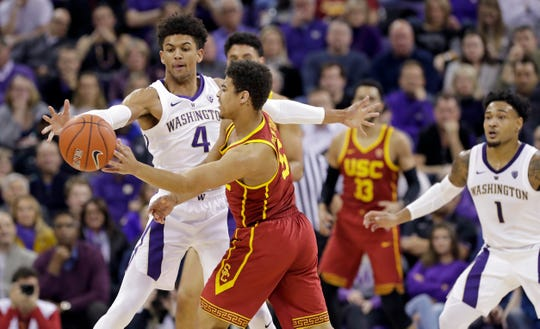 Washington's Matisse Thybulle (4) defends against Southern California's Derryck Thornton during the first half of an NCAA college basketball game Wednesday, Jan. 30, 2019, in Seattle.