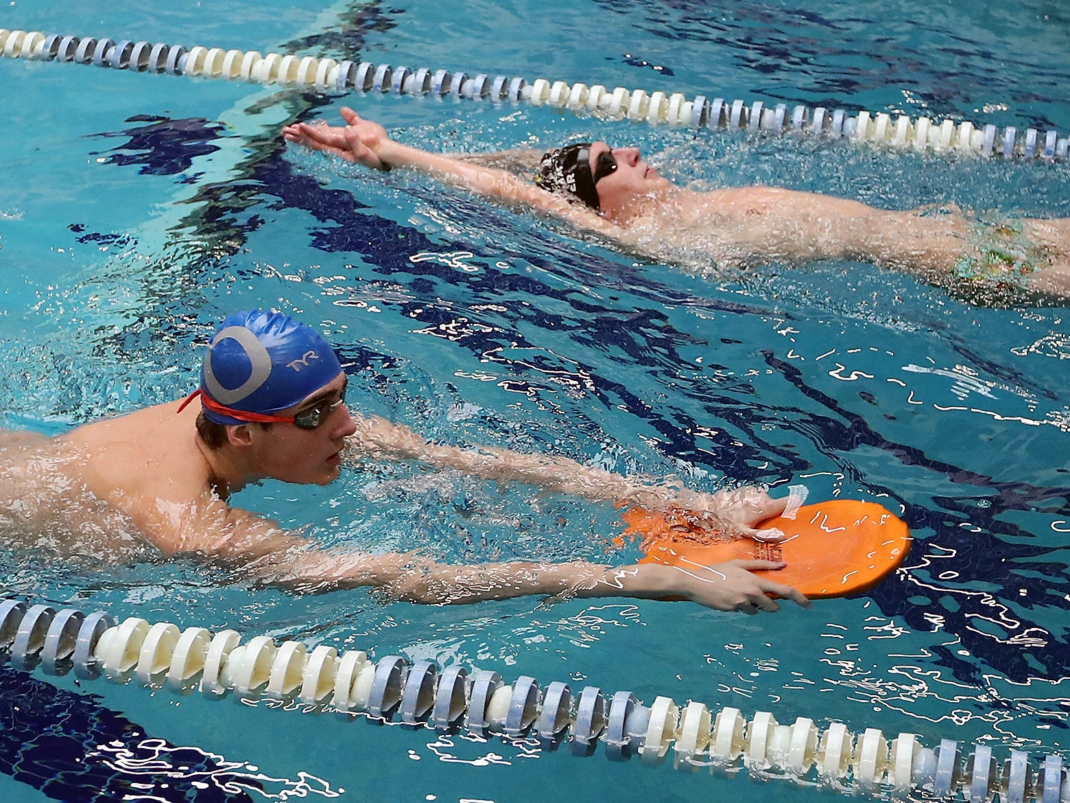 Dietrich Meyer (front) and brother Rainer warmup in the same lane during practice at the Olympic High Pool on Wednesday, January 30, 2019.