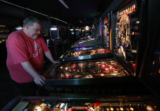 Customer Dan Copenhaver plays a game of pinball at Tik Tok's Workshop in Bremerton on Wednesday, January 30, 2019.
