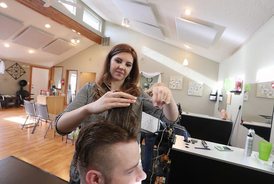 Stylist Abigail Horan cuts Cody Martin's hair at Ashton's Hair Design in Port Orchard. Horan was among the stylists from Kitsap County who protested a bill that could have changed the law on booth rentals in salons.