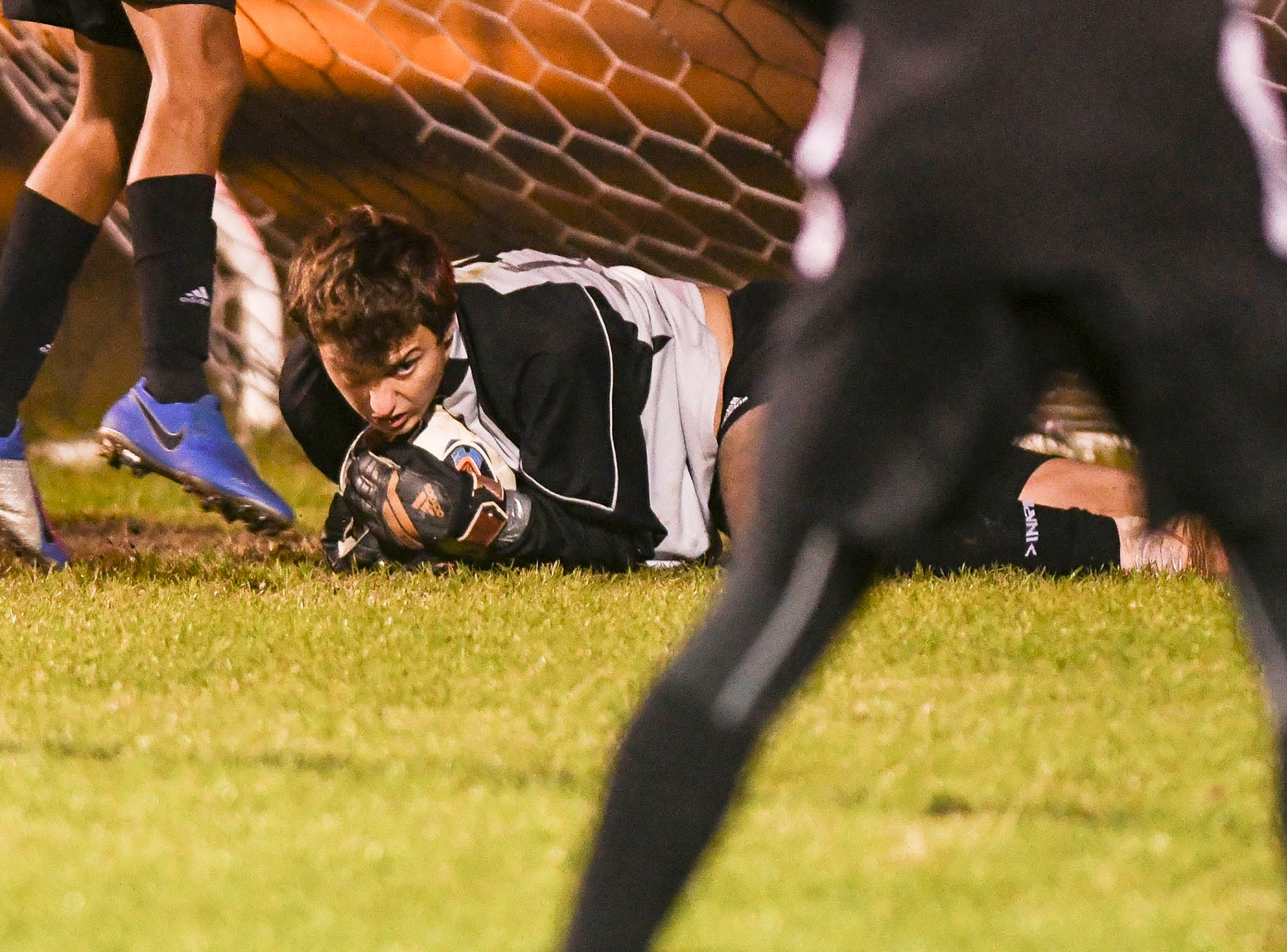 Rockledge goalkeeper Alex Rahal dives on a ball during Wednesday's District 12, Class 3A semifinal against Merritt Island.