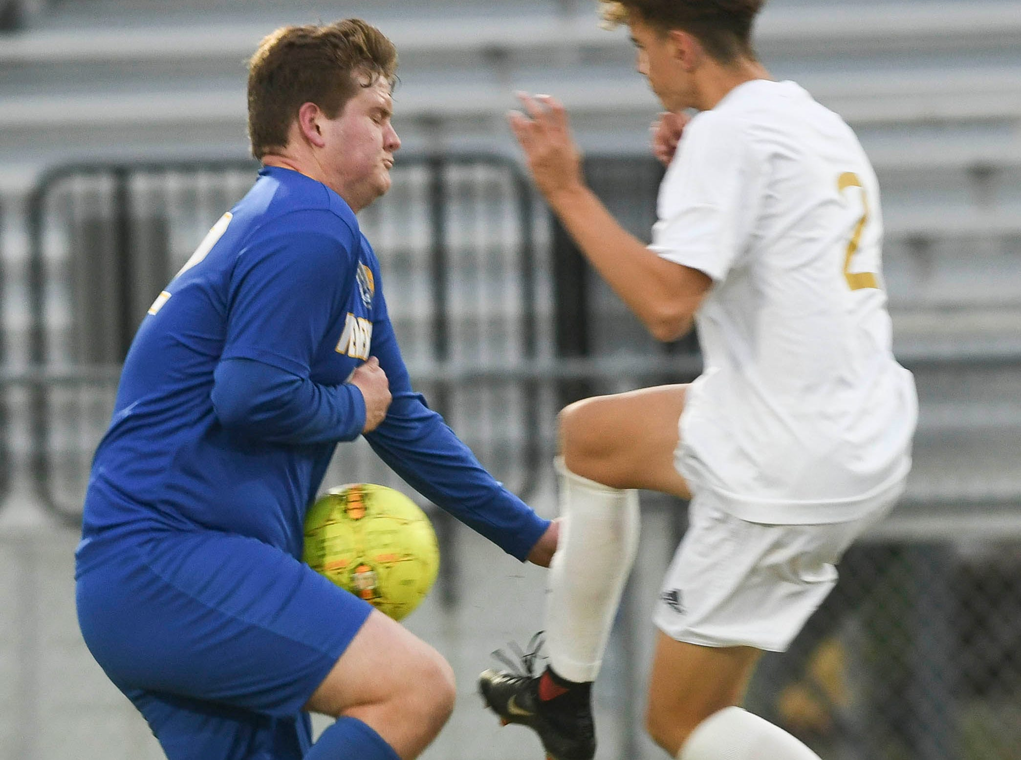 Titusville's Preston Mauzy blocks the way of Eau Gallie's Alex Masedo during Wednesday's District 12, Class 3A semifinal at McLarty Stadium