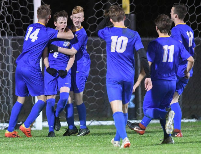 Titusville teammates congratulate Josh Fox (6) after he scored in last year's district tournament.