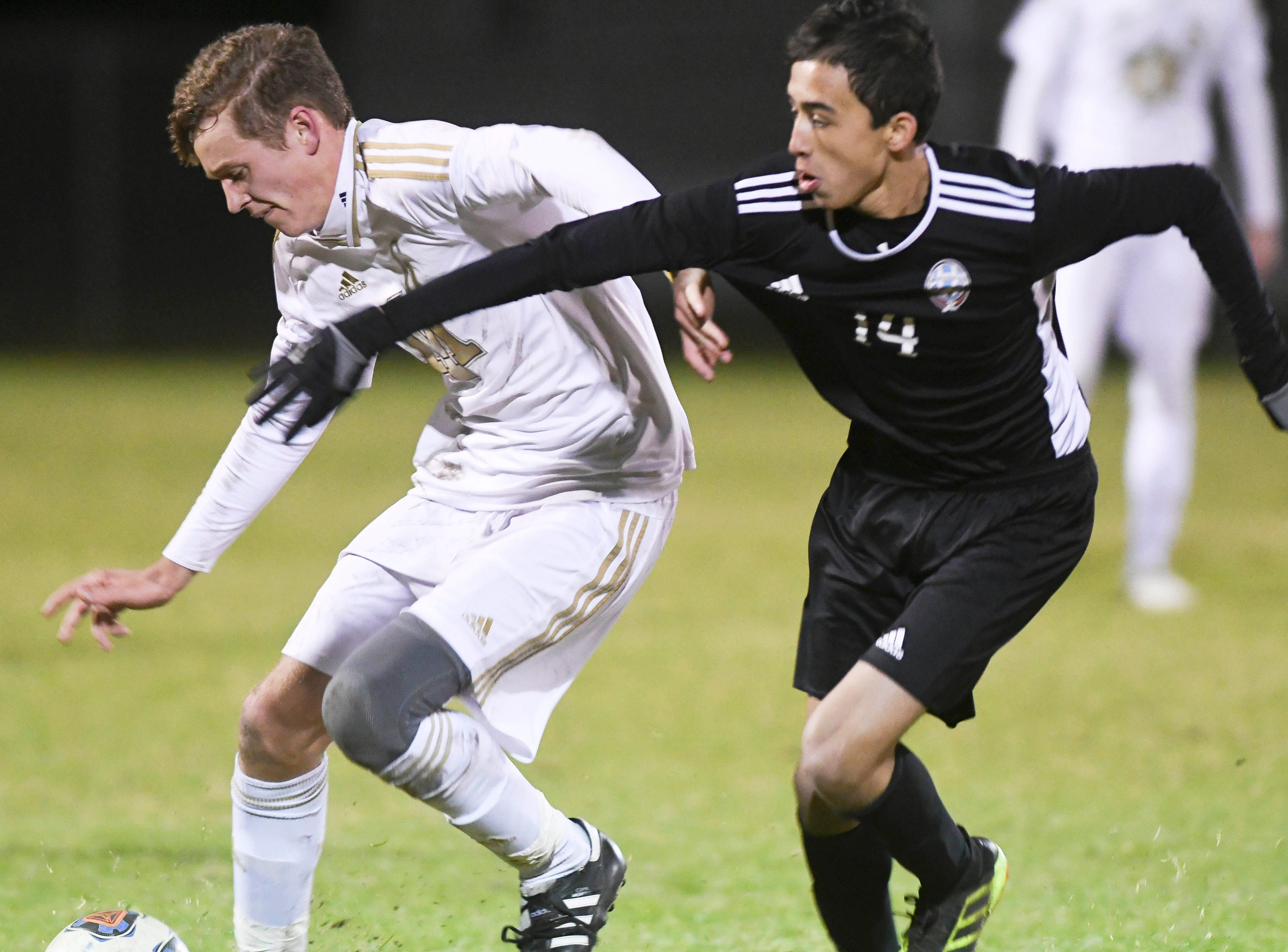 Dan Gerondidakis of Merritt Island and Luis Esteban Son of Rockledge battle for the ball  during Wednesday's District 12, Class 3A semifinal at McLarty Stadium