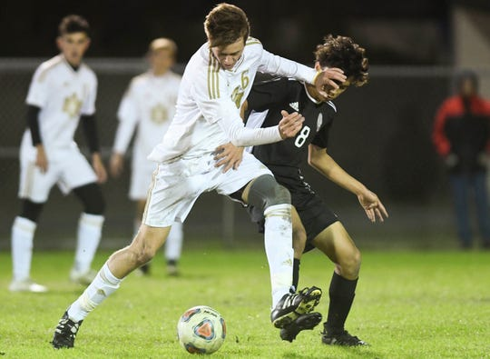 Dan Gerondidakis of Merritt Island and Andrew Inocencio of Rockledge battle for position during Wednesday's District 12, Class 3A semifinal at McLarty Stadium