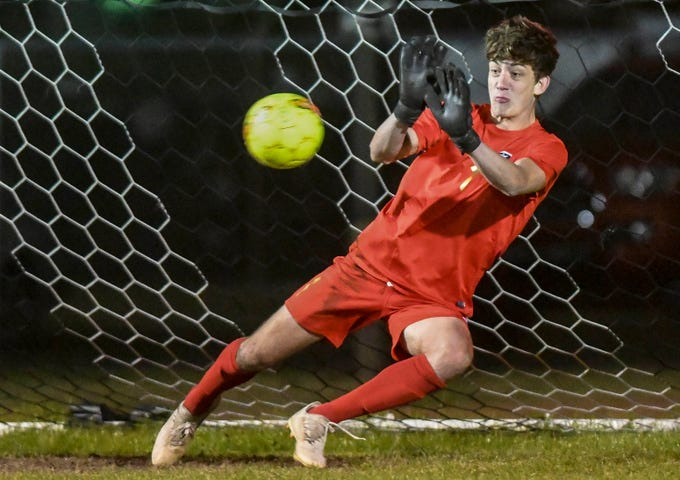 Eau Gallie goalkeeper Jack Smoak blocks a penalty kick during Wednesday's District 12, Class 3A semifinal against Titusville.