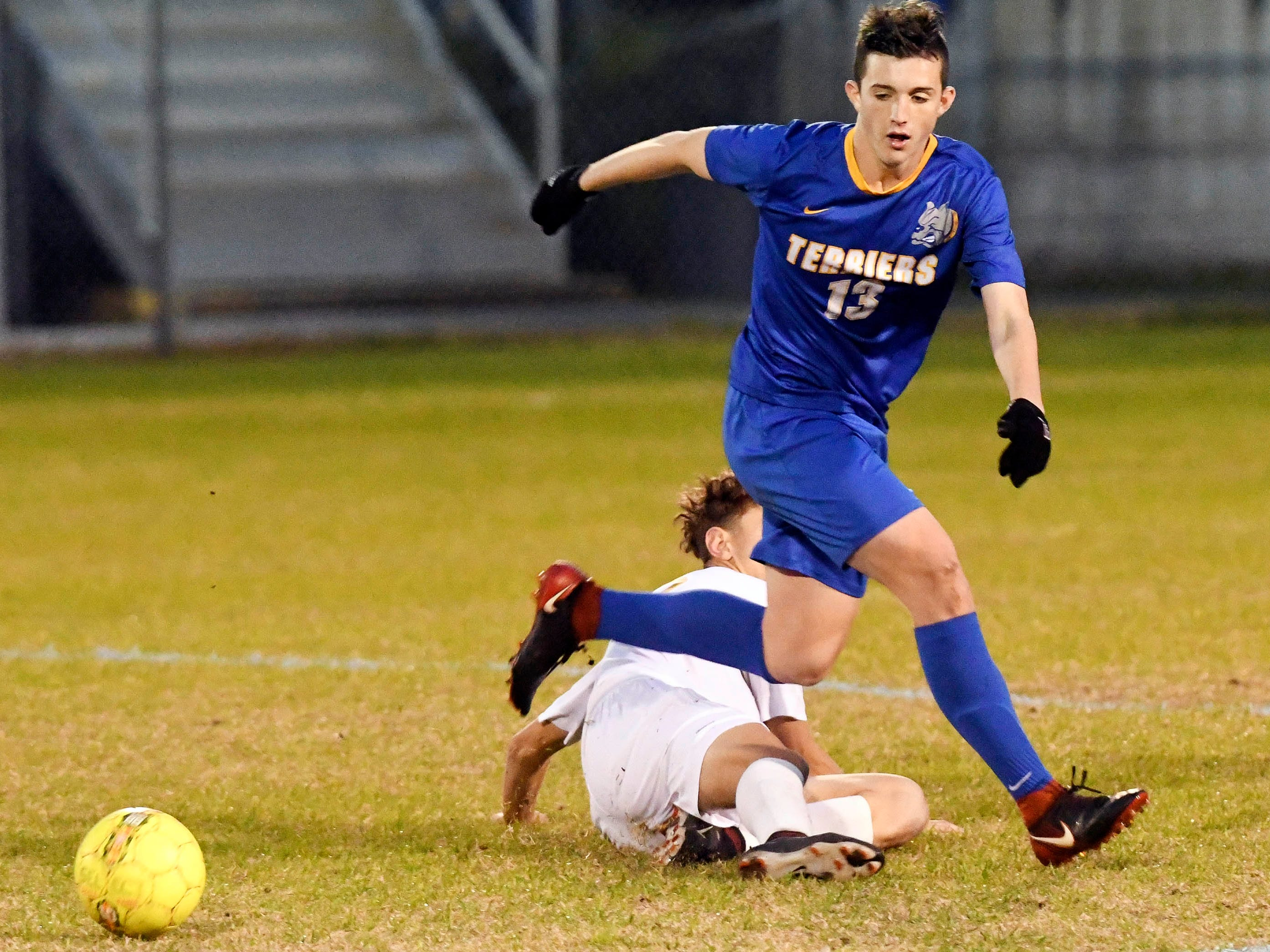 Titusville's Jeremy Pless gets past an Eau Gallie defender during Wednesday's District 12, Class 3A semifinal at McLarty Stadium