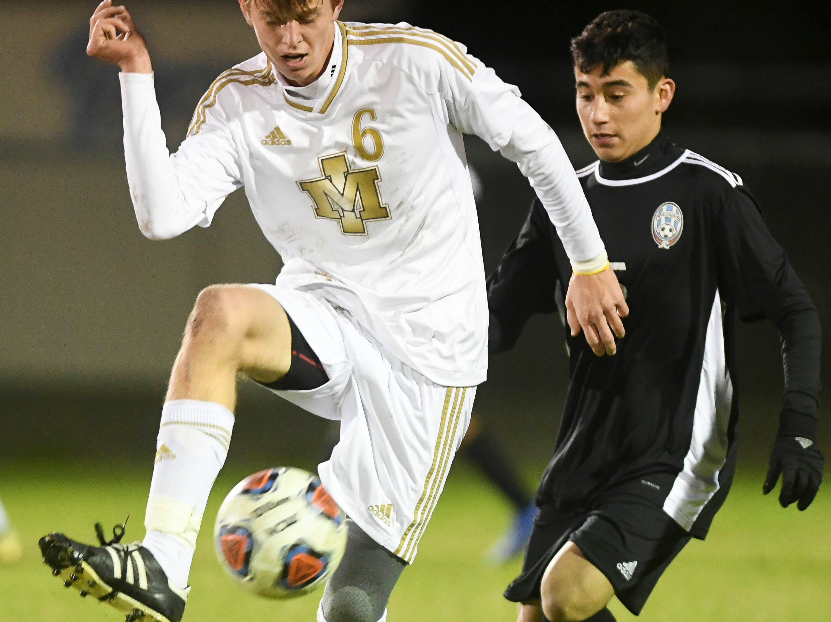 Dan Gerondidakis of Merritt Island settles the ball in front of Arath Castaneda of Rockledge  during Wednesday's District 12, Class 3A semifinal at McLarty Stadium