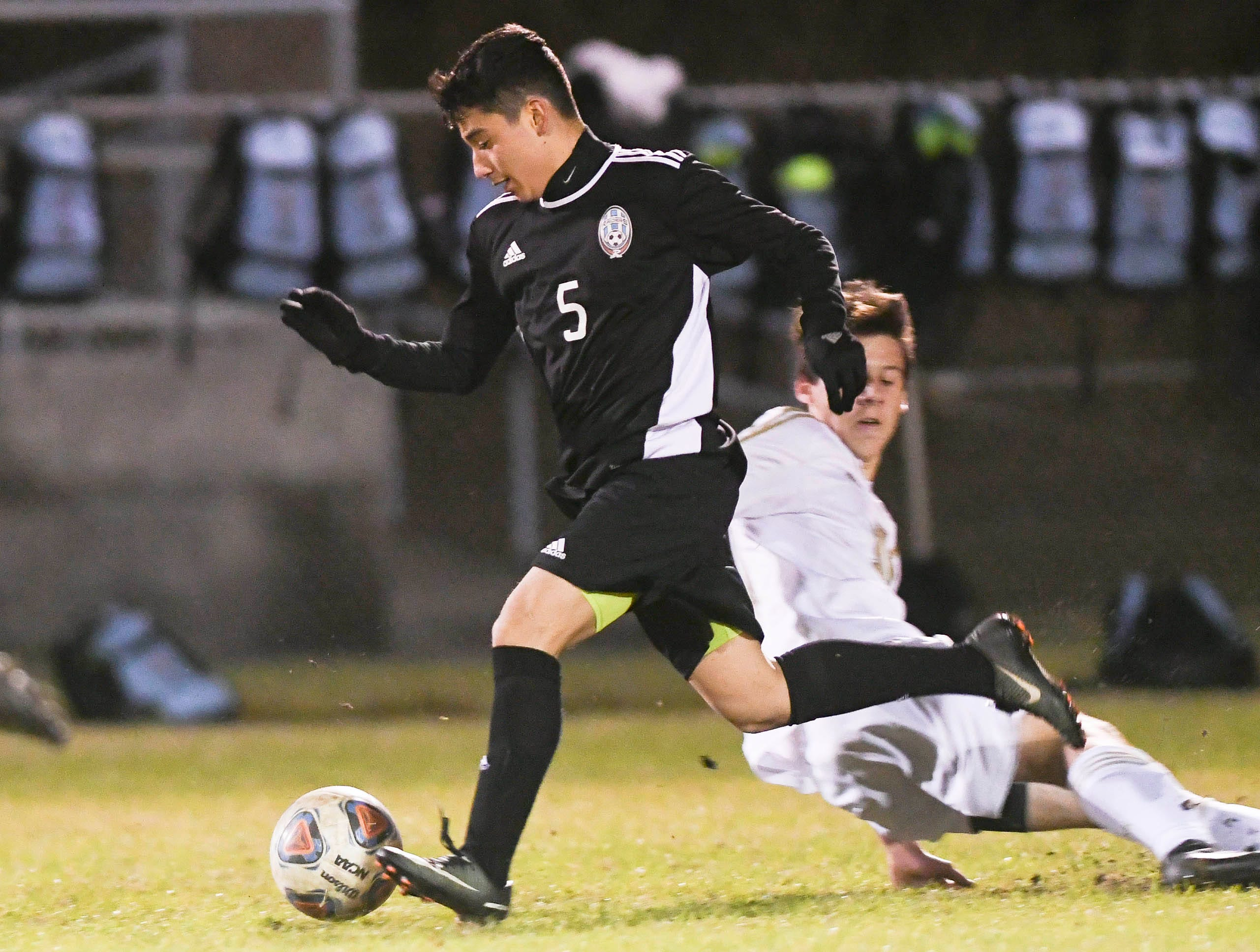 Arath Castaneda of Rockledge drives downfield during Wednesday's District 12, Class 3A semifinal at McLarty Stadium