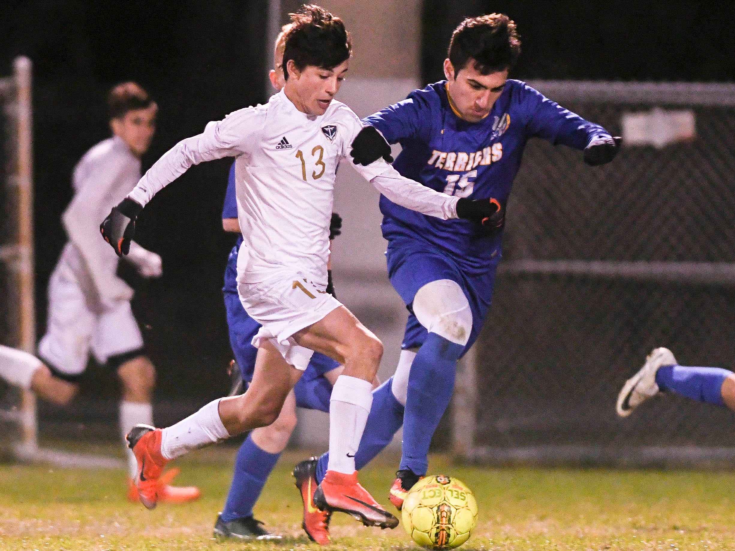 Eau Gallie's Jaxon Supernaw is closely guarded by Mickey Mikitarian of Titusville during Wednesday's District 12, Class 3A semifinal at McLarty Stadium