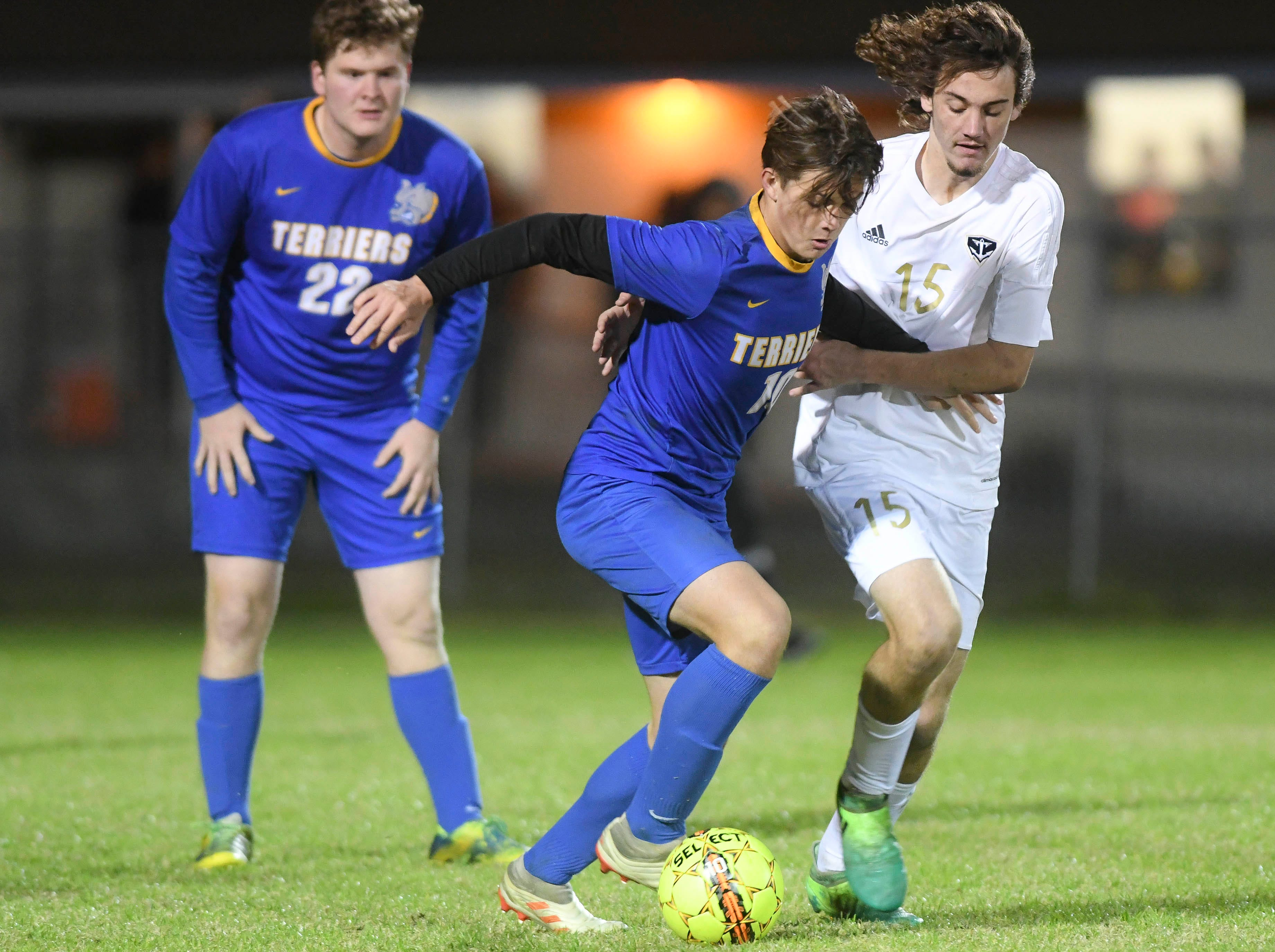 Nathan Pless of Titusville is harassed by Caleb Webb of Eau Gallie during Wednesday's District 12, Class 3A semifinal at McLarty Stadium
