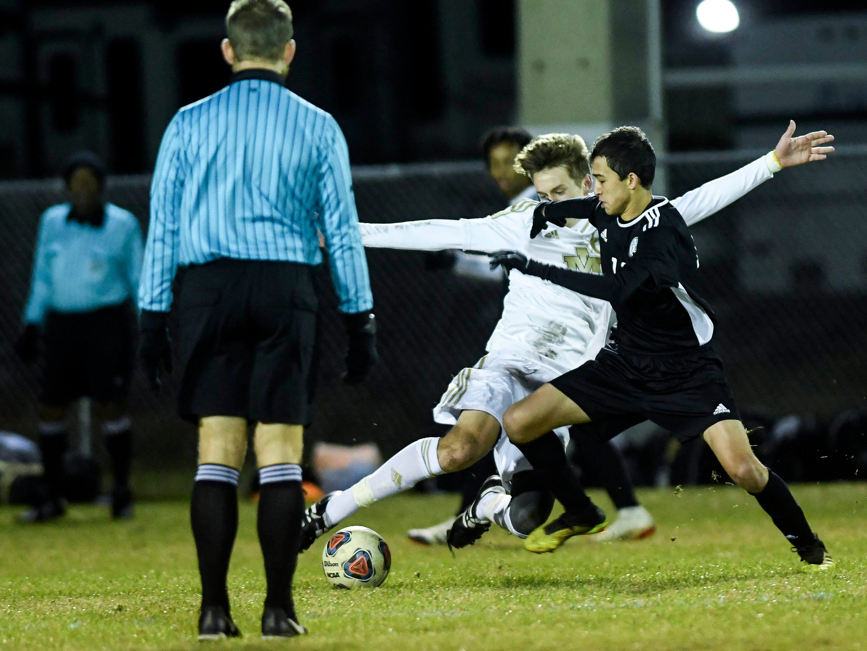 Merritt Island's Dan Gerondidakis and Luis Esteban Son of Rockledge battle for control of the ball during Wednesday's District 12, Class 3A semifinal at McLarty Stadium