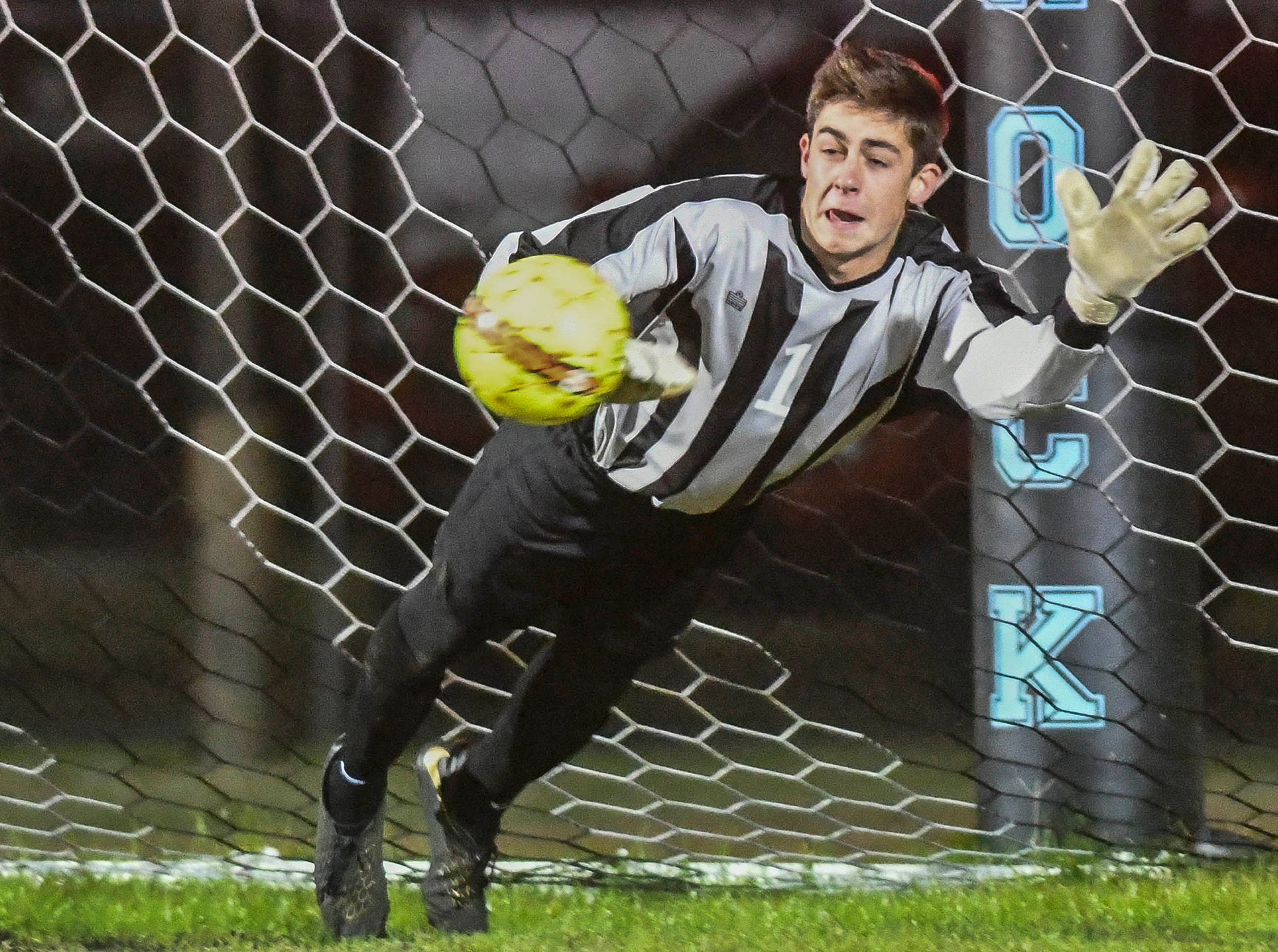 Titusville goalkeeper Roc Irlbeck blocks a penalty kick during Wednesday's District 12, Class 3A semifinal at McLarty Stadium
