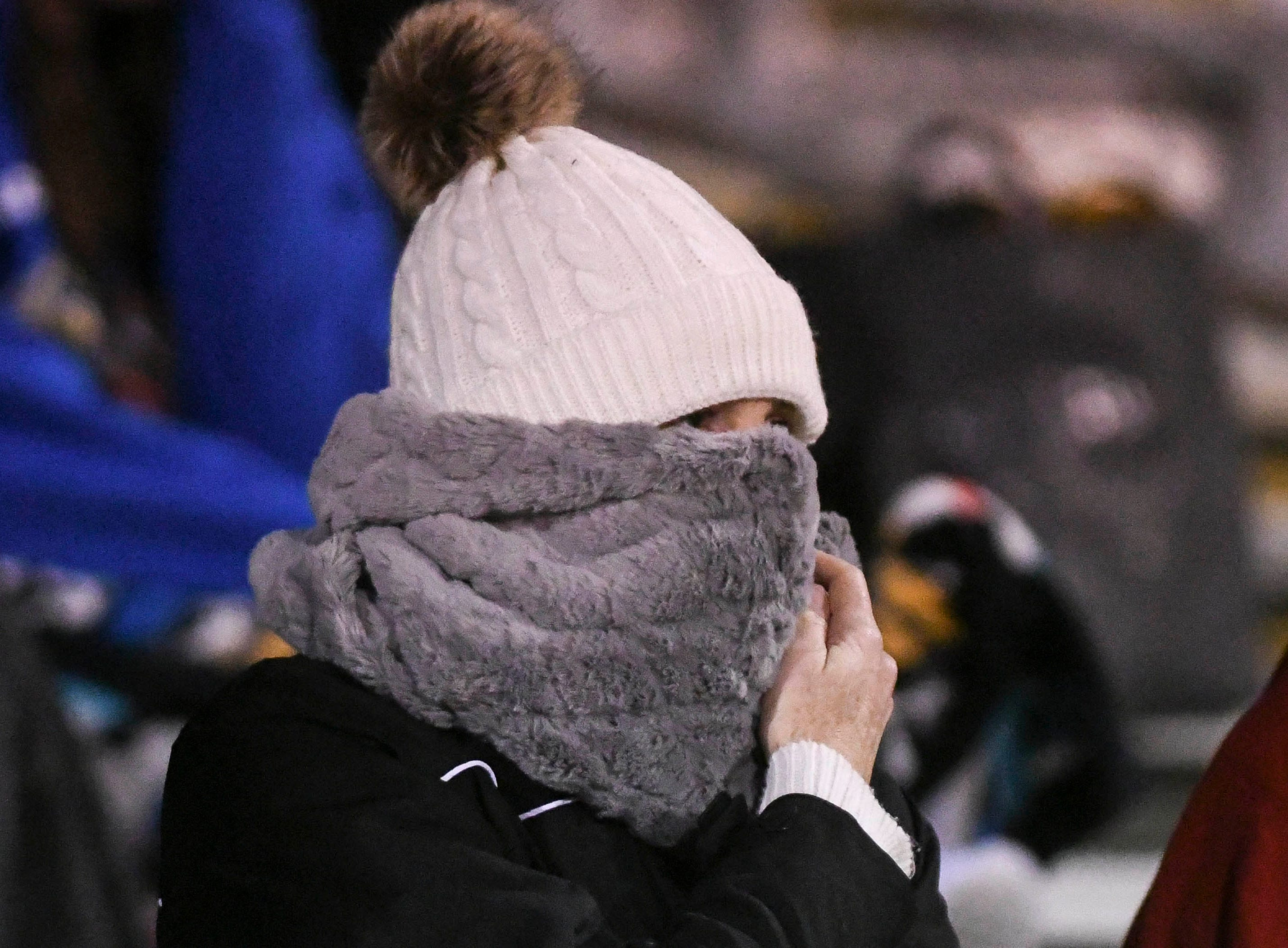 Spectators bundle up against the cold during Wednesday's District 12, Class 3A semifinal at McLarty Stadium.