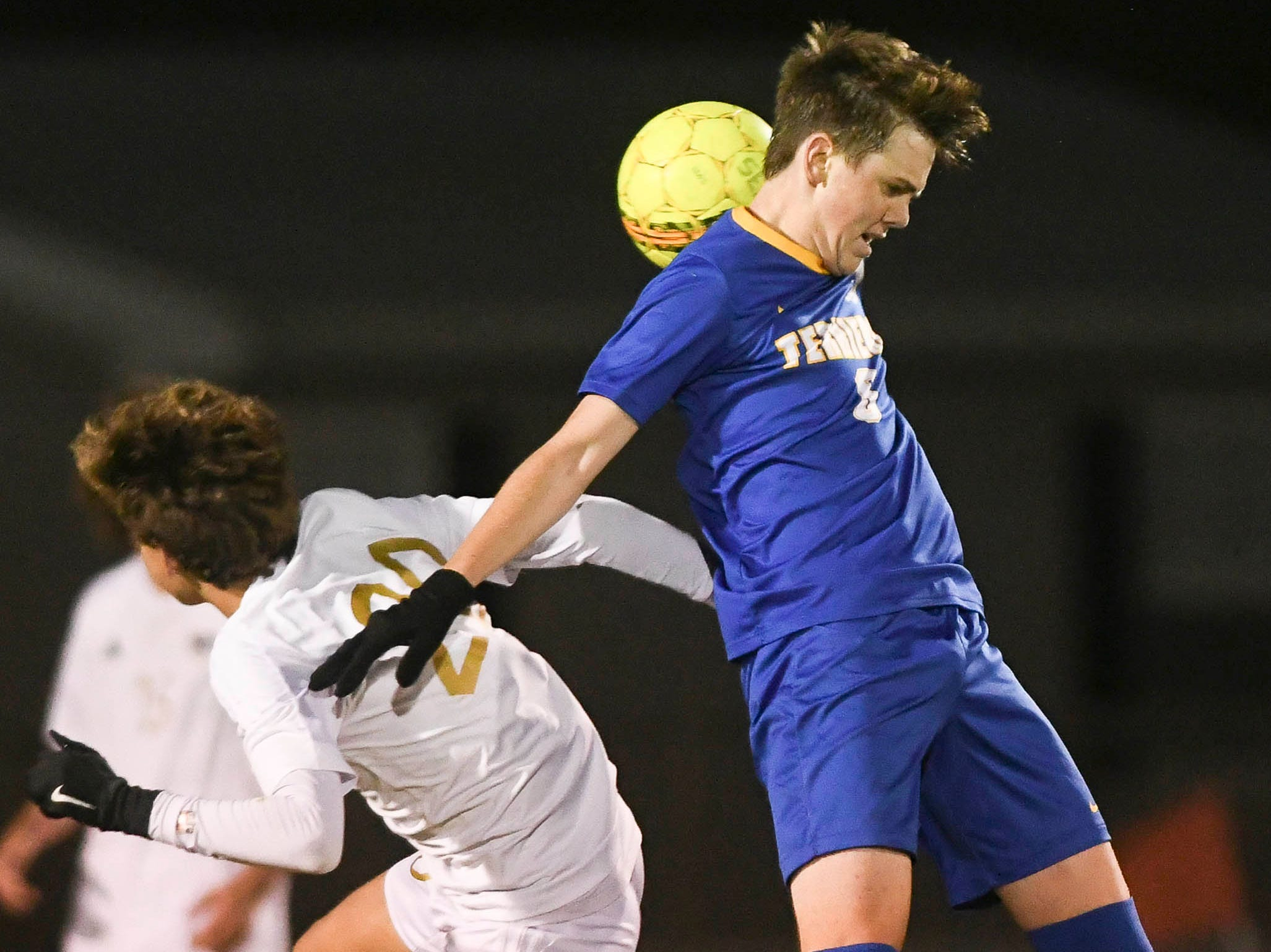 Eau Gallie's Logan Supernaw (20) and Josh Fox of Titusville go for a header during Wednesday's District 12, Class 3A semifinal at McLarty Stadium