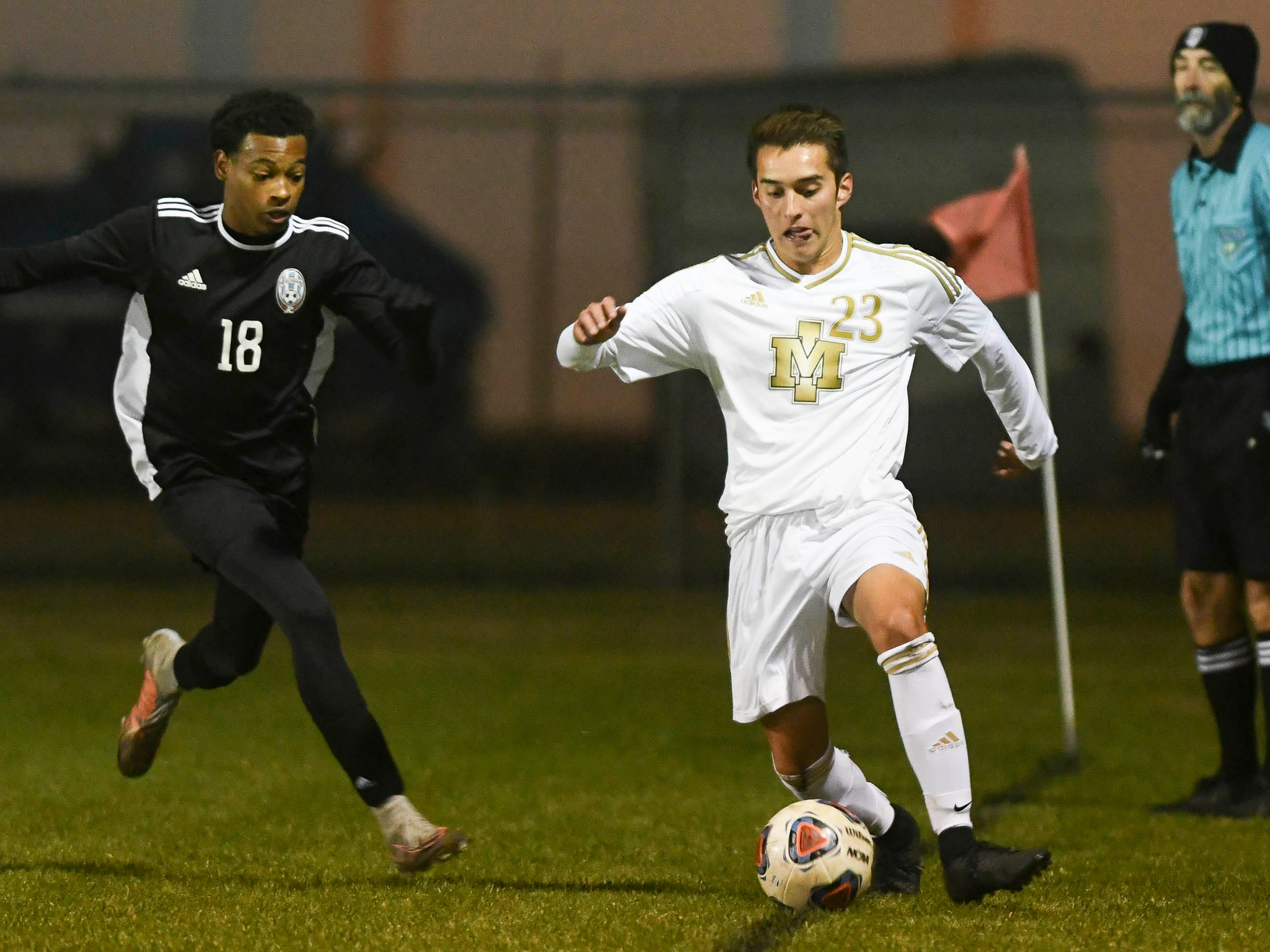 Ethan Mills of Merritt Island (23) is pursued by Ty Moore of Rockledge during Wednesday's District 12, Class 3A semifinal at McLarty Stadium