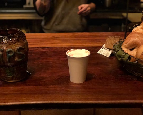 A Muddy Waters hot chocolate with maple-infused cream sits on the counter. Jan. 24, 2019.