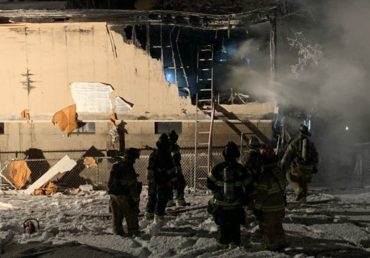 Winooski firefighters respond to a fire in a commercial building and storage units at 103 C WestSpring Street on Wednesday night, Jan. 30, 2019. Crews discovered a body inside.