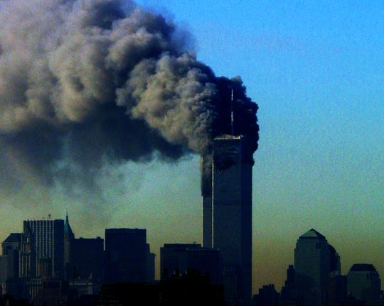 Smoke pours from the World Trade Center towers on the morning of September 11, 2001